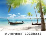 sea  coconut palms and boat | Shutterstock . vector #102286663