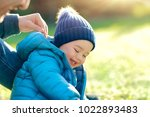 cute little boy with his father ...   Shutterstock . vector #1022893483