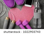 gym stuff  phone and heart on... | Shutterstock . vector #1022903743