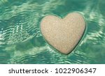 heart made of sand floating in... | Shutterstock . vector #1022906347
