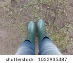 lady in jeans wearing a pair of ... | Shutterstock . vector #1022935387