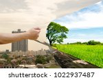 ecology concept hand pull... | Shutterstock . vector #1022937487