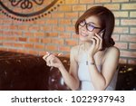 portrait of asian woman eating... | Shutterstock . vector #1022937943