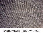 texture of a worn denim | Shutterstock . vector #1022943253