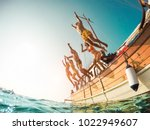 group of happy friends diving... | Shutterstock . vector #1022949607