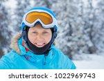 portrait of happy female skier... | Shutterstock . vector #1022969743