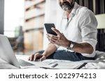 hand of unrecognisable... | Shutterstock . vector #1022974213