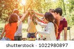 group of happy friends cheering ... | Shutterstock . vector #1022980897