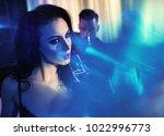 loving couple drinking... | Shutterstock . vector #1022996773