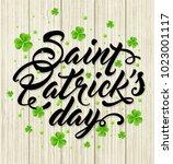 lettering and green clover... | Shutterstock .eps vector #1023001117