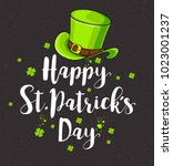 green hat and lettering on a... | Shutterstock .eps vector #1023001237