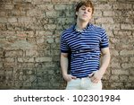 Young handsome man in polo shirt relaxing. - stock photo