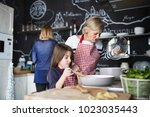 a small girl with mother and... | Shutterstock . vector #1023035443