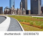 Stock photo green roof on urban building with old city hall toronto 102303673