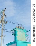 Small photo of Electric substation on a background of blue sky.