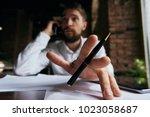 business man talking on the... | Shutterstock . vector #1023058687