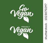 go vegan t shirt design.... | Shutterstock .eps vector #1023070297