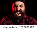 angry screaming bearded man on... | Shutterstock . vector #1023072907