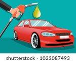 businessman holding a fuel... | Shutterstock .eps vector #1023087493