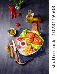 fried chicken with chips and...   Shutterstock . vector #1023119503