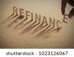 refinance wood word on... | Shutterstock . vector #1023126067