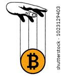 manipulation hand and bitcoin.... | Shutterstock .eps vector #1023129403