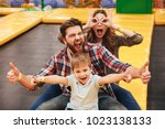 funny young family with their... | Shutterstock . vector #1023138133
