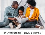 african american parents... | Shutterstock . vector #1023145963