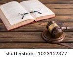 judge gavel  open book and...   Shutterstock . vector #1023152377