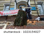 an axe stacked in log on a... | Shutterstock . vector #1023154027