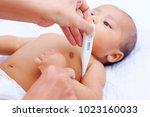 mother measures the temperature ... | Shutterstock . vector #1023160033