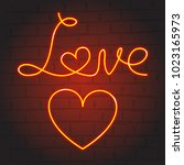 love symbols in neon glow on... | Shutterstock .eps vector #1023165973