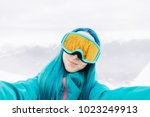 smiling young woman taking... | Shutterstock . vector #1023249913