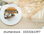 coffee cake  on wooden table... | Shutterstock . vector #1023261397