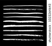set of grunge hand drawn brush... | Shutterstock .eps vector #1023264643