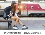 woman waiting railway station.... | Shutterstock . vector #1023285487