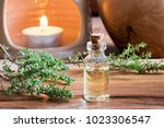 a bottle of thyme essential oil ...   Shutterstock . vector #1023306547