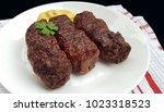 meat rolls  mititei or mici  ... | Shutterstock . vector #1023318523