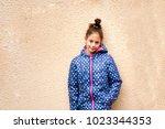 portrait of a little pensive... | Shutterstock . vector #1023344353
