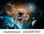 astronaut flies over the earth... | Shutterstock . vector #1023397057