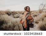 boho woman with windy hair.... | Shutterstock . vector #1023418663