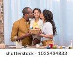 african american parents... | Shutterstock . vector #1023434833