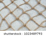old brown nylon rope background | Shutterstock . vector #1023489793