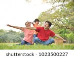 happy young asian family with...   Shutterstock . vector #1023500227