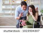 man making marriage proposal to ... | Shutterstock . vector #1023504307