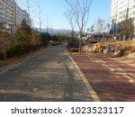 paved pedestrian way or walk... | Shutterstock . vector #1023523117