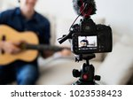 male vlogger recording music... | Shutterstock . vector #1023538423