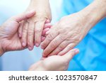 Small photo of Holding hands Asian senior or elderly old lady woman patient with love, care, encourage and empathy at nursing hospital : healthy strong medical concept