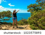 a young tourist girl stands on...   Shutterstock . vector #1023575893