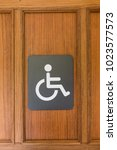 Small photo of An accessible sign for disability people in front of the restroom door.
